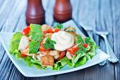 picture of caesar salad  - caesar salad on white plate and on a table - JPG