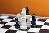 stock photo of chess pieces  - Group of chess pieces on a chess board - JPG