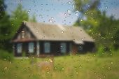 pic of raindrops  - Typical village house with blur effect and raindrops - JPG