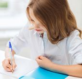 stock photo of little school girl  - education and school concept  - JPG