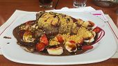foto of crepes  - Crepe with chocolate with a hidden ball of ice cream banana strawberry and two flavors of syrup - JPG