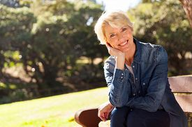 foto of retirement age  - cheerful mid age woman looking at the camera - JPG