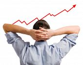 stock photo of business success  - Young businessman looking at his growing share - JPG