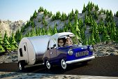 stock photo of camper  - A cartoon Image of a couple driving in the deset towing a camper trailer - JPG