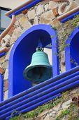 stock photo of hacienda  - Blue bell ornament on a hacienda style hotel - JPG