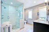 Refreshing Bathroom With Walk In Shower And Cast-iron Radiator poster