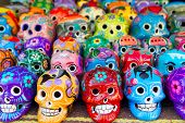 image of memento  - Aztec skulls Mexican Day of the Dead colorful handcrafts