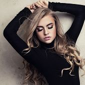 Blonde Sexy Girl With Long Hair And Glamour Makeup. poster