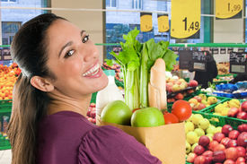 image of healthy eating girl  - Young woman holding a grocery bag full of fresh and healthy food inside a supermarket - JPG