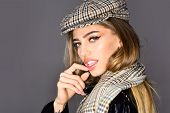 Glamourous Portrait Of The Beautiful Woman In Stylish Hat And Scarf. Trend Fashion Look. Beauty Fash poster