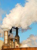 pic of belching  - The smoke stacks of a factory belching out smoke - JPG