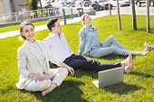 Work Outside. Three Prosperous Managers Feeling Relieved While Working Outside On Hot Pleasant Summe poster