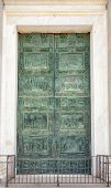 Bronze door of Roman Catholic Pisa Cathedral at Piazza dei Miracoli (Piazza del Duomo), an important poster