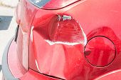 Red Scratched Car With Damaged Paint In Crash Accident Or Parking Lot And Dented Damage Of Metal Bod poster