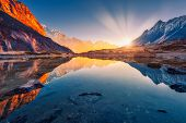 Beautiful Landscape With High Mountains With Illuminated Peaks, Stones In Mountain Lake, Reflection, poster