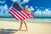 Smiling Woman With American Flag Bikini Waving American Flag In Spectacular Tropical Lanikai Beach,  poster