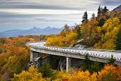 stock photo of mountain-ash  - Blue Ridge Parkway Autumn Linn Cove Viaduct Fall Foliage Mountains bridge at Grandfather Mountain Western North Carolina - JPG