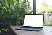 Mockup Image Of Laptop With Blank White Desktop Screen On Vintage Wooden Table With Nature Backgroun poster
