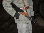picture of hider  - this is a photo of solider whit riffle - JPG