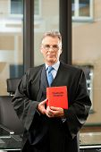 German Lawyer with civil law code in a court room