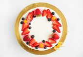Cake With Whipped Cream, Fresh Strawberries, Blueberries And Physalis. Top View. Picture For A Menu  poster