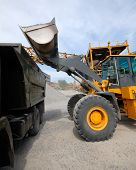 Diesel Loader Will Load Construction Crushed Stone. Loading In A Warehouse Of Building Materials. poster