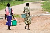 image of water shortage  - In many African villages water is a luxury and everyday people walk few kilometers to get it.