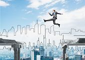 Businessman Jumping Over Gap In Concrete Bridge As Symbol Of Overcoming Challenges. Cityscape On Bac poster
