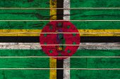 National Flag  Of Dominica On A Wooden Wall Background. The Concept Of National Pride And A Symbol O poster