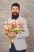 Macho Getting Ready Romantic Date. Tulips For Sweetheart. Romantic Gift. Man Well Groomed Wear Blue  poster