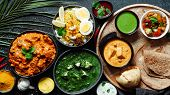 Indian Cuisine Dishes: Tikka Masala, Paneer, Samosa, Chapati, Chutney, Spices. Indian Food On Dark B poster