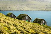 Picturesque view of tradicional faroese grass-covered houses in the village Bour during autumn. Vaga poster