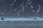 Surfing On Picturesque Arctic Beach On Lofoten Islands In Norway, The Iconic Travel Destination For  poster