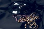 Black Carnival Mask And Beads On A Fabric Background. Accessory For Carnival. poster