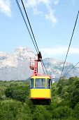 Cable Car Cabin On A Mountain Background. The Rise Of The Cable Car To The Mountains In The Summer poster