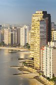 Tall Buildings Near To The Beach Of A Coastal City On A Sunset. Paulista Coast, Sao Vicente City - S poster