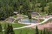 Amazing Children Playgroud With Small Natural Pool Under Sonntagskogel Mountain In Alps, Sankt Johan poster