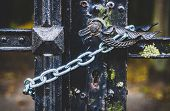 Handle And Lock Of Very Old Cast Iron Gate Locked With Chain poster