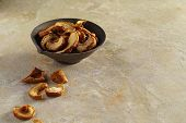 Dried Apple Slices In A Ceramic Cup And On A Textured Yellow Background, Apple Dried Fruits Are Scat poster