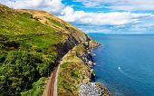 View From Cliff Walk Bray To Greystones With Beautiful Coastline, Cliffs, Sea And Train Tracks, Irel poster