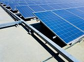 Selective Focus At Front Of Electrical Solar Power Panel System On The Top Of Industrial Building Ge poster