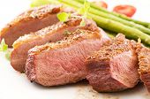 stock photo of barbary duck  - duck breast fillet with asparagus - JPG