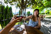 Man And Woman Toasting Red And White Wine Glasses Selective Focus, Winery Restaurant Terrace, Man Po poster