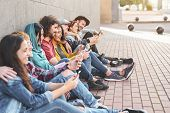 Group Trendy Friends Using Smart Mobile Phones Outdoor - Millennial People Having Fun With New Techn poster