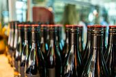 Dark Black Amber Glass Wine Bottles Top, With Red Screw Cap Seal, Close Up And Selective Focus View, poster
