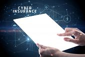 Holding futuristic tablet with CYBER INSURANCE inscription, cyber security concept poster