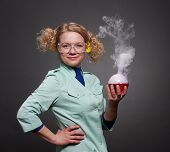 image of retort  - Funny woman chemist  with solutions on gray - JPG