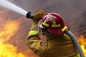 stock photo of firefighter  - Firefighters at work on an old beach house