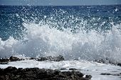 stock photo of shoreline  - High wave breaking on the rocks of the coastline - JPG