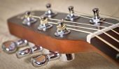 foto of peg  - an Acoustic guitar head with tuning pegs